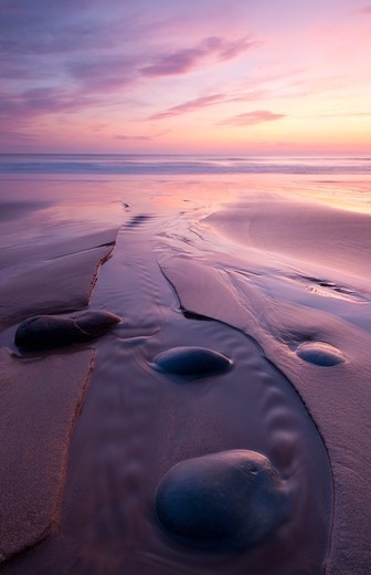 Sandymouth Bay at sunset, with rocks and reflections, Cornwall, England, UK. April 2010. : Stock Photo