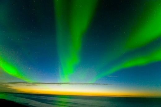Northern lights (Aurora borealis) across the night sky, over the Beaufort Sea, off shore from the 1002 area of the Arctic National Wildlife Refuge, Alaska September 2009 : Stock Photo