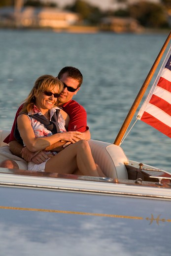Couple aboard Surf Hunter 33 Jet boat off Marco Island, Florida. : Stock Photo