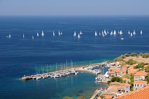 Stock Photo: 4115-6434 Overview of Molyvos / Mithymna harbour, and sailing yachts racing in the Aegean regatta. Lesbos / Lesvos, Greece, August 2010.
