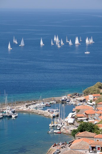 Stock Photo: 4115-6435 Overview of Molyvos / Mithymna harbour, and sailing yachts racing in the Aegean regatta. Lesbos / Lesvos, Greece, August 2010