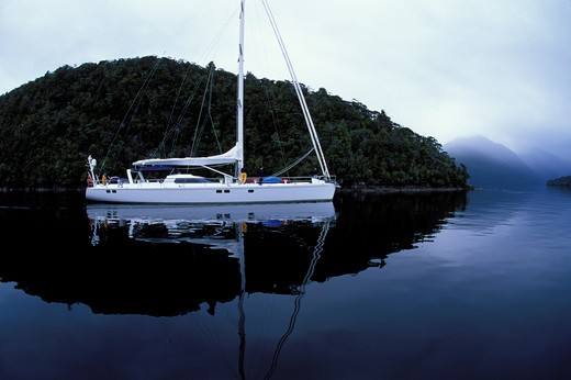 88ft yacht 'Shaman' motoring through fjords of South Island, New Zealand : Stock Photo