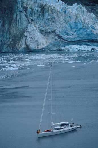 Stock Photo: 4115-994 88ft sloop 'Shaman' anchored at the foot of a glacier, Kenai peninsula, Alaska. 2001