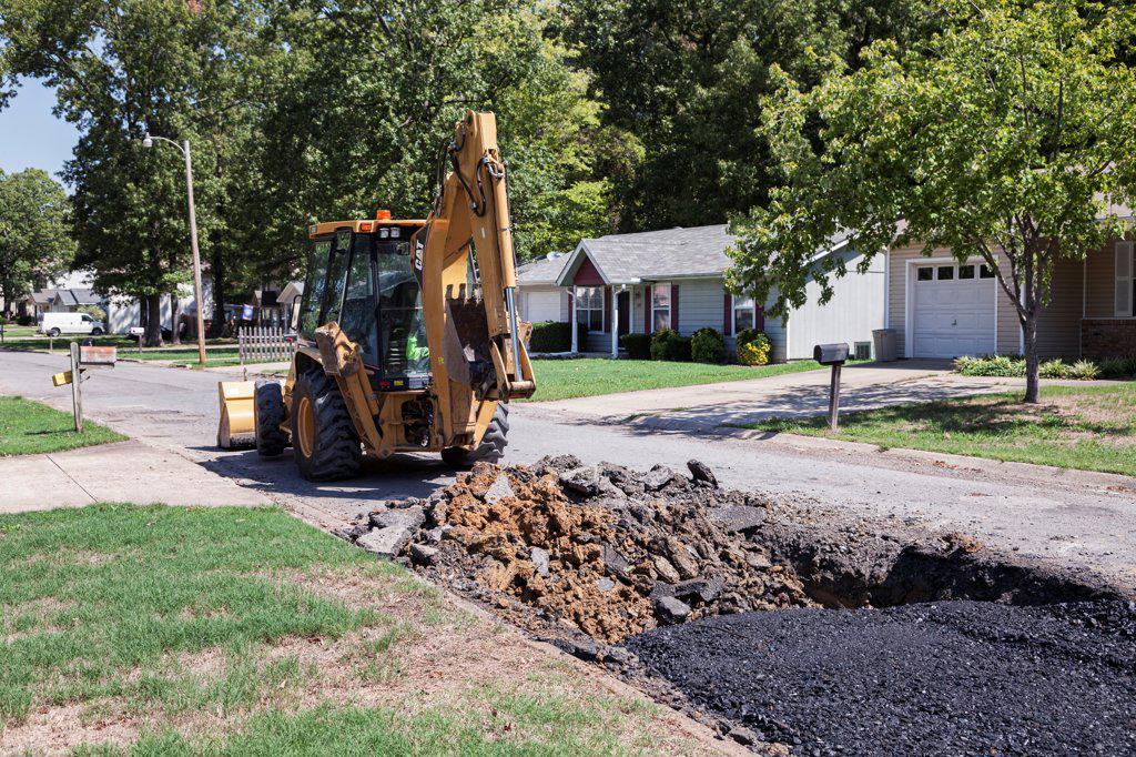 USA, Arkansas, Excavator repairing driveway : Stock Photo