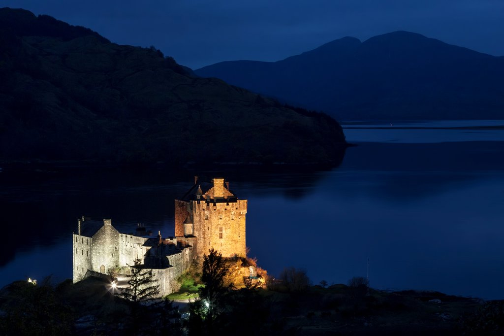 Castle lit up at night, Eilean Donan Castle, Loch Alsh, Dornie, Scotland : Stock Photo