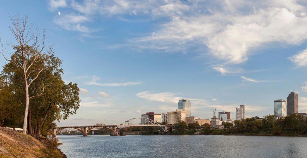 Bridge with city skyline at the waterfront, Arkansas River, Little Rock, Pulaski County, Arkansas, USA : Stock Photo