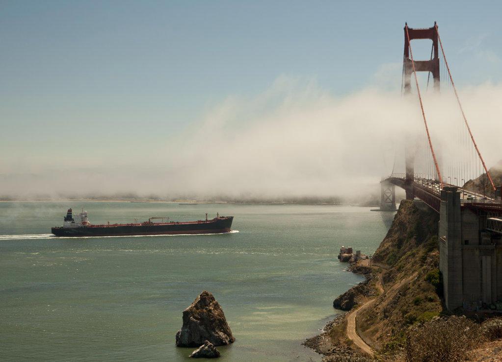 Container ship passing under the Golden Gate Bridge, San Francisco Bay, San Francisco, California, USA : Stock Photo