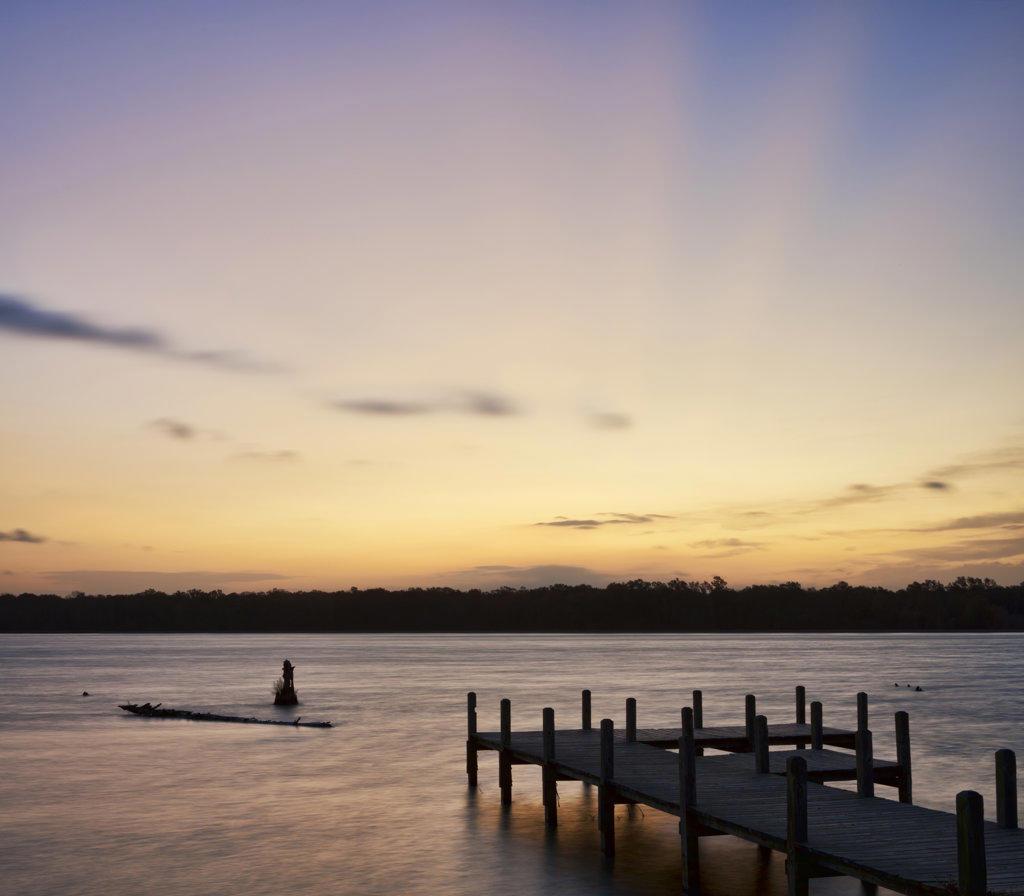 USA, Arkansas, Pickthorne Lake with pier at dawn : Stock Photo