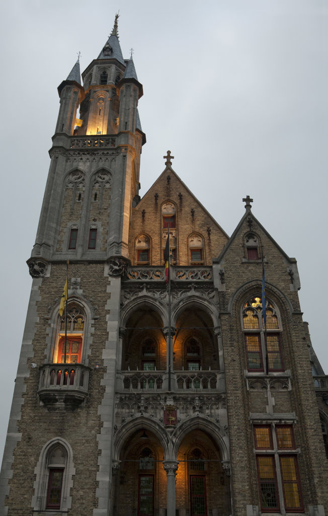 Low angle view of a church lit up at evening, Poperinge, West Flanders, Flemish Region, Belgium : Stock Photo
