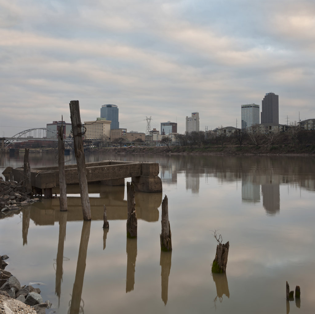 Ruins of a pier with city in the background, Little Rock, Arkansas River, Arkansas, USA : Stock Photo