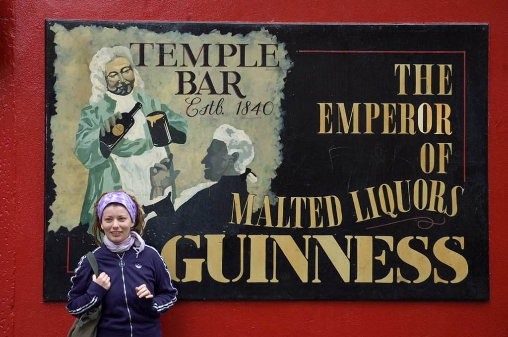 Photograph of a young woman outside an Irish pub : Stock Photo