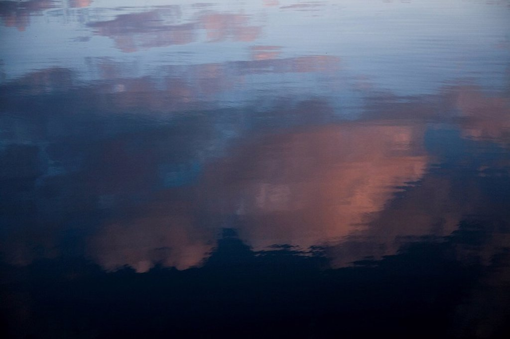 Abstract view of the evening sky reflection in the Norweigan sea : Stock Photo