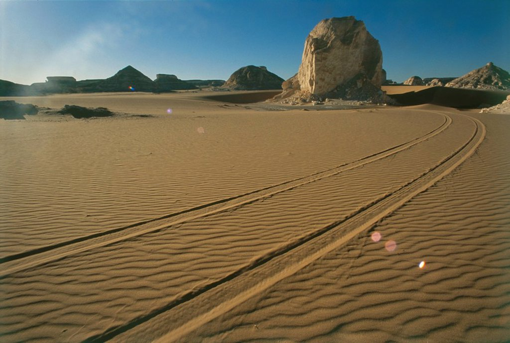 Stock Photo: 4119-8123 Photograph of tire tracks in the sand of the western desert of Egypt