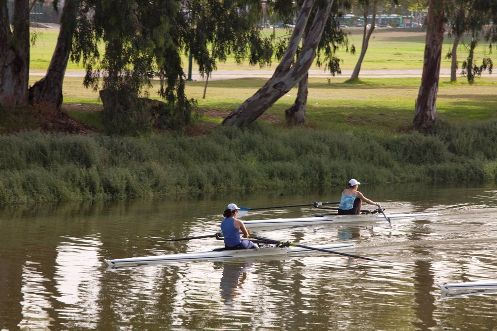 Photograph of kayakers on the poluted Yarkon stream : Stock Photo