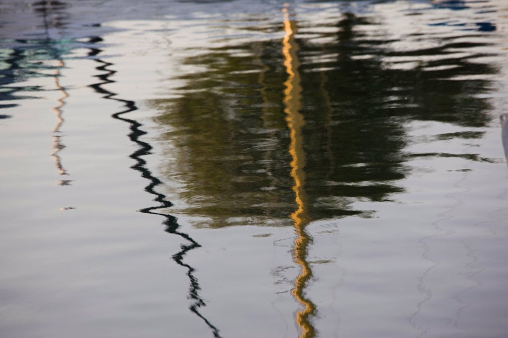 Abstract photograph of the reflection of the boats in a marina in Cyprus : Stock Photo