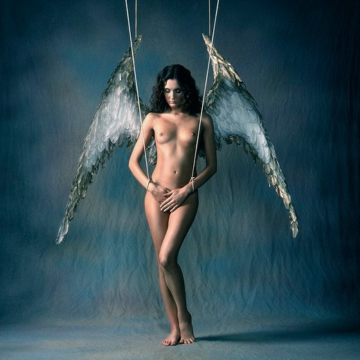 Naked woman as angel : Stock Photo