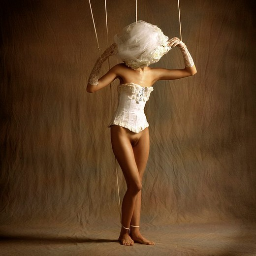 Woman as a marionette : Stock Photo