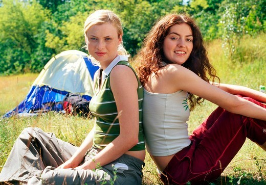 Stock Photo: 4123-11047 Two girls on meadow