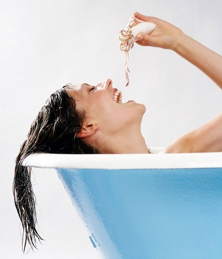 Girl taking bath with octobus : Stock Photo