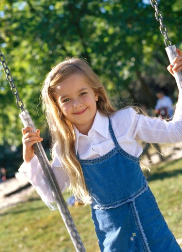 Girl on the playground : Stock Photo