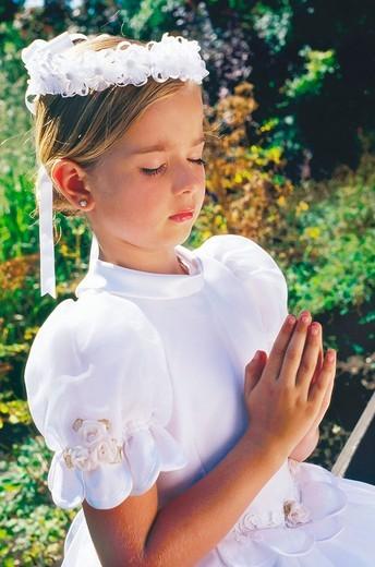 Stock Photo: 4123-11654 Girl wearing communion dress