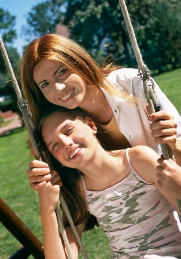 Mother with daughter on the swing : Stock Photo