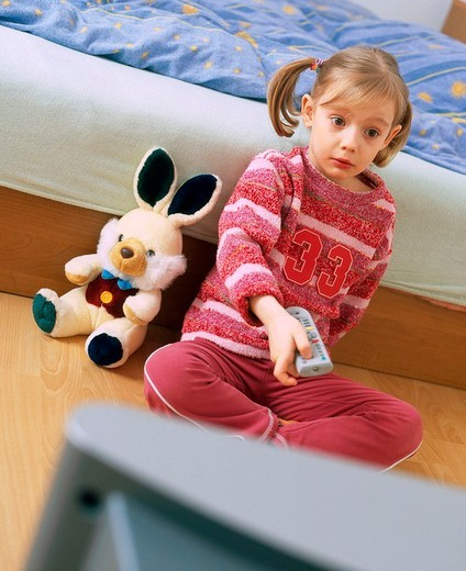 Stock Photo: 4123-1238 Girl watching tv