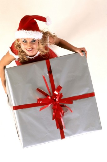 Stock Photo: 4123-12450 Girl with gift wearing christmas disguise