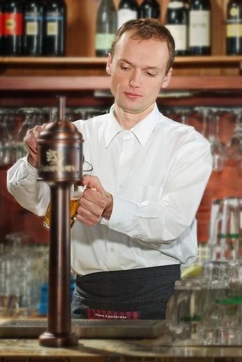 Stock Photo: 4123-12894 Barman pouring beer at pub