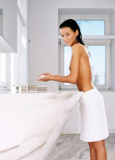 Stock Photo: 4123-13132 Woman in bathroom