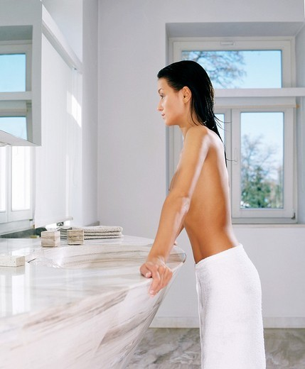 Stock Photo: 4123-13148 Woman in bathroom