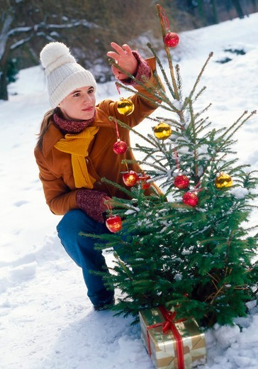 Woman at the christmas tree : Stock Photo