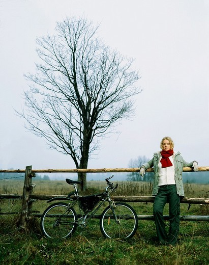Woman with bike : Stock Photo