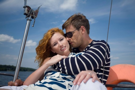 Couple resting on the sailing boat : Stock Photo