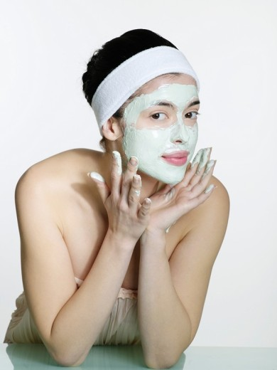 Young woman´s portrait in the face mask : Stock Photo