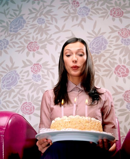 Woman with birthday cake : Stock Photo