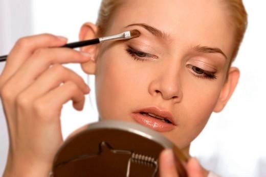 Woman doing make up : Stock Photo