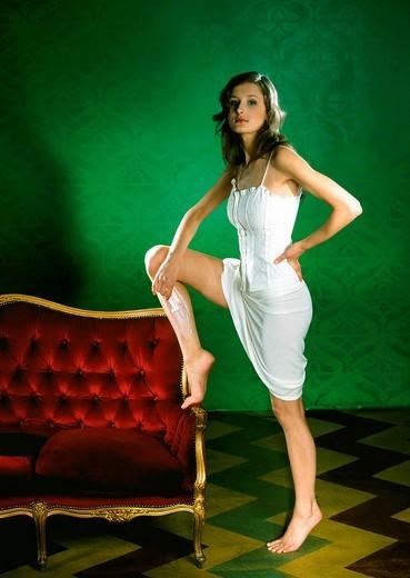 Woman shaving legs : Stock Photo