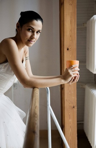 Ballet dancer with mug in the gym : Stock Photo