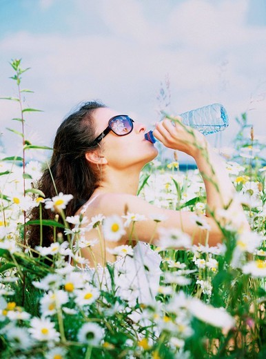 Woman on meadow : Stock Photo