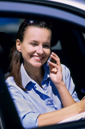 Woman with mobile in the car : Stock Photo