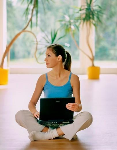 Stock Photo: 4123-20621 Woman working on laptop