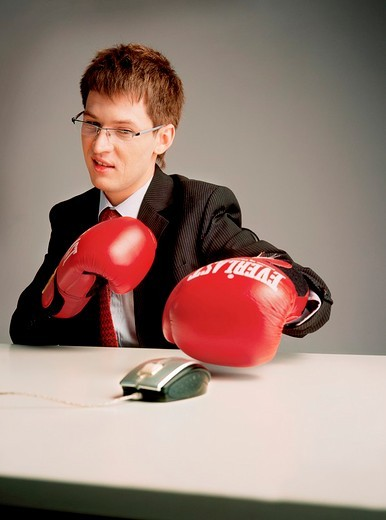 Stock Photo: 4123-22197 Businessman with boxing gloves