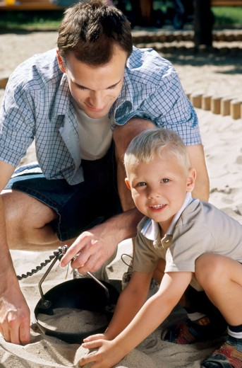 Father and son on playground : Stock Photo