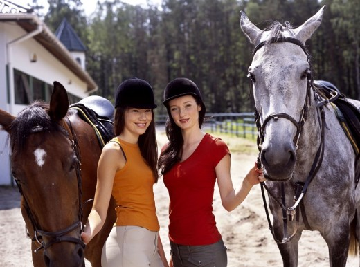 Stock Photo: 4123-23660 Girls with horses
