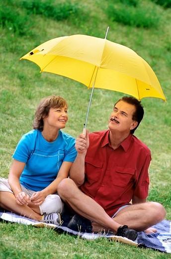 Couple with umbrella : Stock Photo