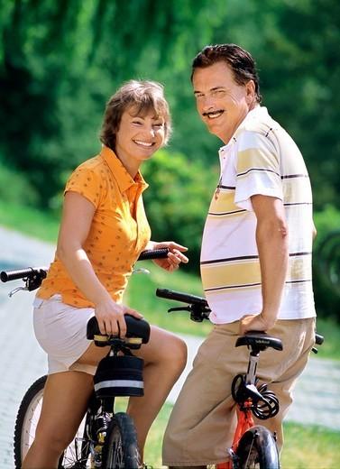 Couple with bikes : Stock Photo