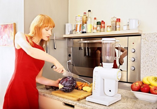 Woman in the kitchen : Stock Photo