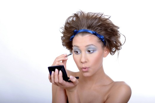 Girl doing make up : Stock Photo
