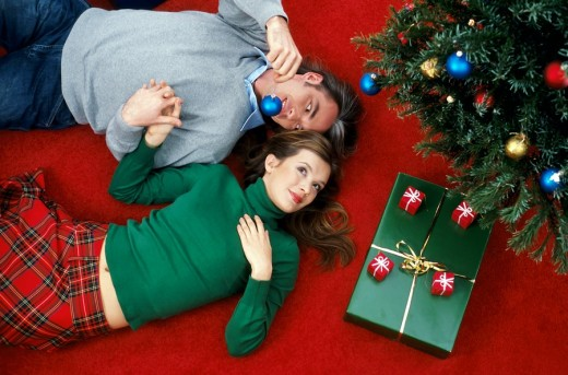 Couple at christmas tree : Stock Photo
